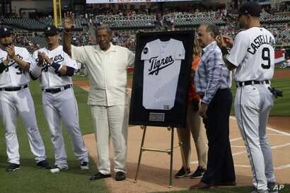 Pedro Sierra, pitcher for the Negro Leagues' Detroit Stars and Indianapolis Clowns from 1954-1958 receives a Tigre's baseball jersey during a pre-game ceremony,  Aug. 12, 2017, in Detroit.