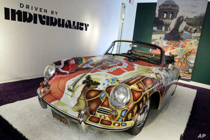 Singer Janis Joplin's painted 1964 Porsche 356C Cabriolet car for sale at Sotheby's in New York, Dec. 4, 2015. (AP Photo/Richard Drew)
