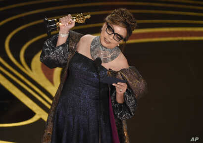 "Ruth E. Carter accepts the award for best costume design for ""Black Panther"" at the Oscars on Sunday, Feb. 24, 2019, at the Dolby Theatre in Los Angeles."