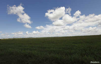 FILE - Clouds gather over state owned agriculture land near the village of Quivican, near Havana, Oct. 11, 2009.