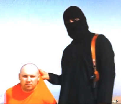 "FILE - This image from an undated video purports to show U.S. journalist Steven Sotloff being held by the IS militant later dubbed ""Jihadi John."""