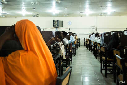 Students take their final exams at the computer science department. More than 20,000 students are enrolled at the University of Maiduguri. (C. Oduah/VOA)