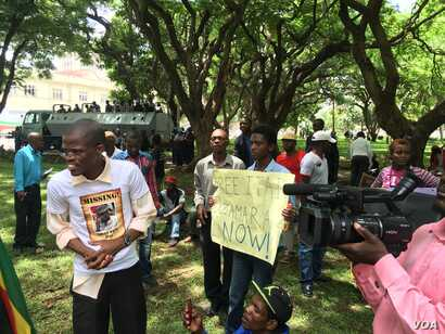 Police maintained a heavy presence at Wednesday's protest march but did not deter activists from accusing President Robert Mugabe's government of failing to respect human rights. (S. Mhofu/VOA)