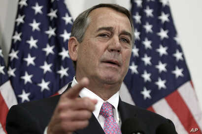 Outgoing House Speaker John Boehner of Ohio talks with reporters on Capitol Hill in Washington, Oct. 27, 2015. House Republican leaders pushed toward a vote on a two-year budget deal despite conservative opposition.