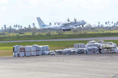 A World Food Program plane takes off from Beira International Airport after dropping off supplies for survivors of Cyclone Idai in Beira, Mozambique, March, 31, 2019.
