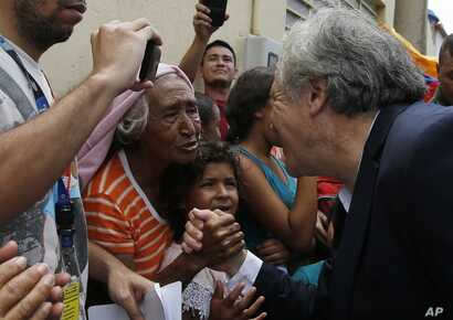 Organization of American States Secretary-General Luis Almagro greets Venezuelan migrants in La Parada, Colombia, Sept. 14, 2018. Almagro traveled to the Colombia's border with Venezuela to monitor the situation of migrants who have been fleeing the ...