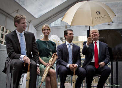 Donald Trump (R) along with his children Eric (L), Ivanka (2nd L) and Donald Jr. attend a ceremony announcing a new hotel and condominium complex in Vancouver, British Columbia June 19, 2013.