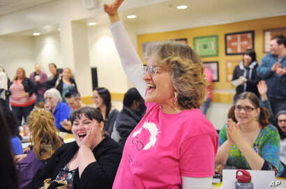 Bernie Sanders supporter Maryellen Lambert reacts at the Democratic Party caucus in Anchorage, Alaska, March 26, 2016.