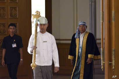 Parliament chairman Mann Win Khaing Than, right, walks to attend the inauguration session of Union Parliament, Feb. 8, 2016, in Naypyitaw, Myanmar.