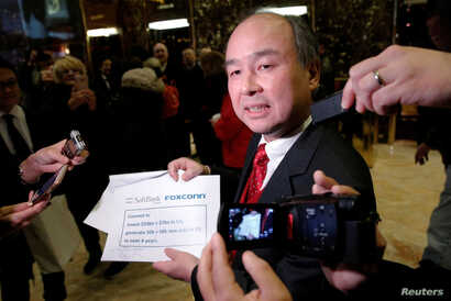 Softbank CEO Masayoshi Son speaks to the press after meeting with U.S. President-elect Donald Trump at Trump Tower in Manhattan, New York, Dec. 6, 2016.