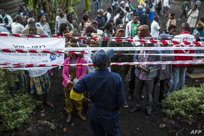 Witnesses and voters wait for the Katendere voting center to open in Goma, Dec. 30, 2018. Voters in the Democratic Republic of Congo went to the polls Sunday in elections that will shape the future of their vast, troubled country