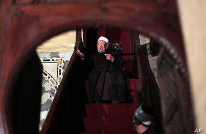 FILE -- In this Dec. 28, 2012, photo, Shiekh Youssef al-Qaradawi, gives the sermon during the Friday prayer at Al-Azhar mosque in Cairo, Egypt.