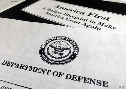 A portion of President Donald Trump's first proposed budget, focusing on the Department of Defense, and released by the Office of Management and Budget, is photographed in Washington, March 15, 2017.