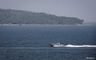 An Indian Navy boat patrols in the waters of the Andaman Sea near Port Blair, the capital of India's Andaman and Nicobar islands, March 16, 2014. India on Sunday put on hold its search for missing Malaysia Airlines flight MH370, at the request of the
