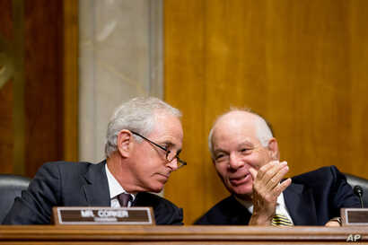 Chairman Bob Corker, R-Tenn., left, and ranking member Ben Cardin, D-Md., right, confer as the State Department's Thomas Shannon testifies at a Senate Foreign Relations Committee hearing on Capitol Hill in Washington, April 5, 2016.