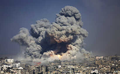 FILE - In this July 29, 2014 photo, smoke and fire from an Israeli air strike rise over Gaza City.