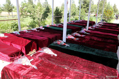Coffins containing the bodies of Afghan national Army (ANA) soldiers killed in April 21's attack on an army headquarters are lined up in Mazar-i-Sharif, northern Afghanistan, April 22, 2017.