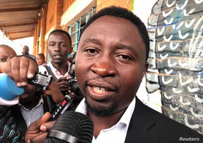 Green Party presidential candidate Frank Habineza addresses the media after casting his vote in Kigali, Rwanda, Aug. 4, 2017.