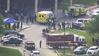 In this image taken from video, emergency personnel and law enforcement officers respond to a high school near Houston after an active shooter was reported on campus, May 18, 2018, in Santa Fe, Texas.