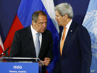 Russian Foreign Minister Sergei Lavrov, left, speaks to U.S. Secretary of State John Kerry prior to their news conference in Vienna, Austria, May 17, 2016.