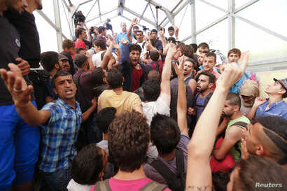 Migrants gather at the railway station in the town of Bicske, Hungary, Sept. 3, 2015.