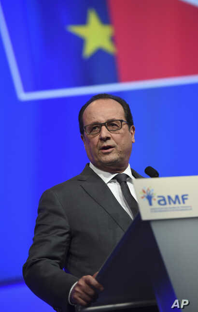 French President Francois Hollande delivers a speech during a meeting with French mayors in Paris, Nov. 18, 2015.