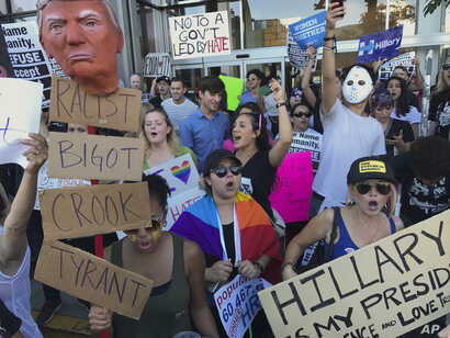 Protesters hold banners during a rally in opposition to President-elect Donald Trump, in the Hollywood section of Los Angeles, California, Nov .13, 2016. Rallies in various U.S. cities entered their fifth day on Sunday.