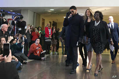 Empire actor Jussie Smollett arrives a news conference after a hearing at the Leighton Criminal Court Building, March 26, 2019, in Chicago.
