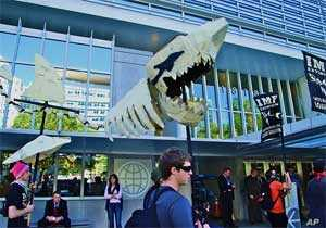 """Demonstrators compared the IMF to a """"loan shark"""" and urged an end to what they called unjust economic policies"""