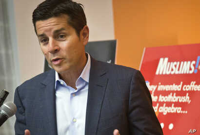 FILE - Muslim comedian Dean Obeidallah speaks at a news conference in New York, June 25, 2015.