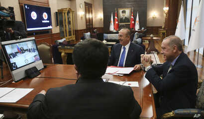 Turkey's President Recep Tayyip Erdogan, right, gestures as he speaks to Venezuela's President Nicolas Maduro during a conference call, in Ankara, Turkey, May 17, 2018.