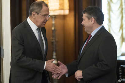 Russian Foreign Minister Sergey Lavrov, left, shakes hands with German counterpart Sigmar Gabriel in Moscow, Russia, March 9, 2017.