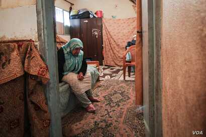 Eishi Ibraham Ayash was born in Palestine and had to flee refugee camps in Lebanon three times because of violence. She has little hope that she will be rehoused. (John Owens for VOA)