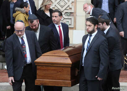A casket is carried from Rodef Shalom Temple after funeral services for brothers Cecil and David Rosenthal, victims of the Tree of Life Synagogue shooting, in Pittsburgh, Pennsylvania, Oct. 30, 2018.