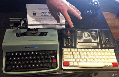 """A 1964 Olivetti Lettera 32 and a Freewrite — a modern, smart typewriter that sends typed documents to the cloud — are on display at a """"type-in"""" in Albuquerque, N.M., April 23, 2017."""