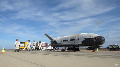 This undated photo provided by the U.S. Air Force shows an X-37B Orbital Test Vehicle at NASA's Kennedy Space Center in Florida. An unmanned Falcon rocket that carried one of these experimental planes blasted off Thursday, Sept. 7, 2017, from Florida...
