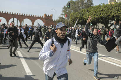 Protesting teachers run from security forces attempting to disperse a demonstration in Rabat, Morocco, Feb. 20, 2019.