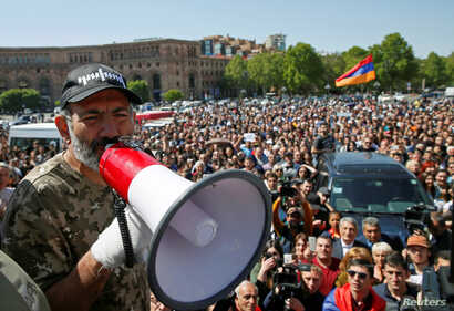 Armenian opposition leader Nikol Pashinyan addresses supporters during a rally in Yerevan, Armenia, April 25, 2018.