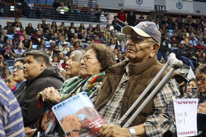John Nez, right, and Mabel Nez, seated to his right, attend the Navajo Nation inauguration on Tuesday, Jan. 15, 2019, in Fort Defiance, Ariz.