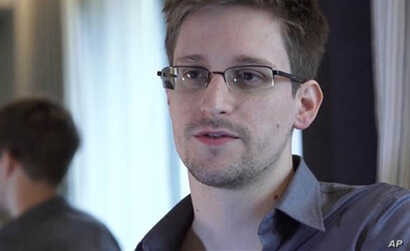Edward Snowden, who worked as a contract employee at the National Security Agency, speaks to The Guardian newspaper in Hong Kong, June 9, 2013.