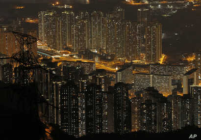Tightly-packed buildings are seen from the Fei Ngo Shan in the night in Hong Kong, Saturday, April 1, 2017.