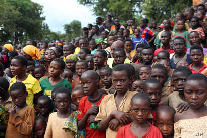 FILE - In this photo taken Dec. 29 2015, Burundian refugees attend a rally addressed by Tanzania Prime Minister Kassim Majaliwa, at Nduta refugee camp in Kigoma, Tanzania.