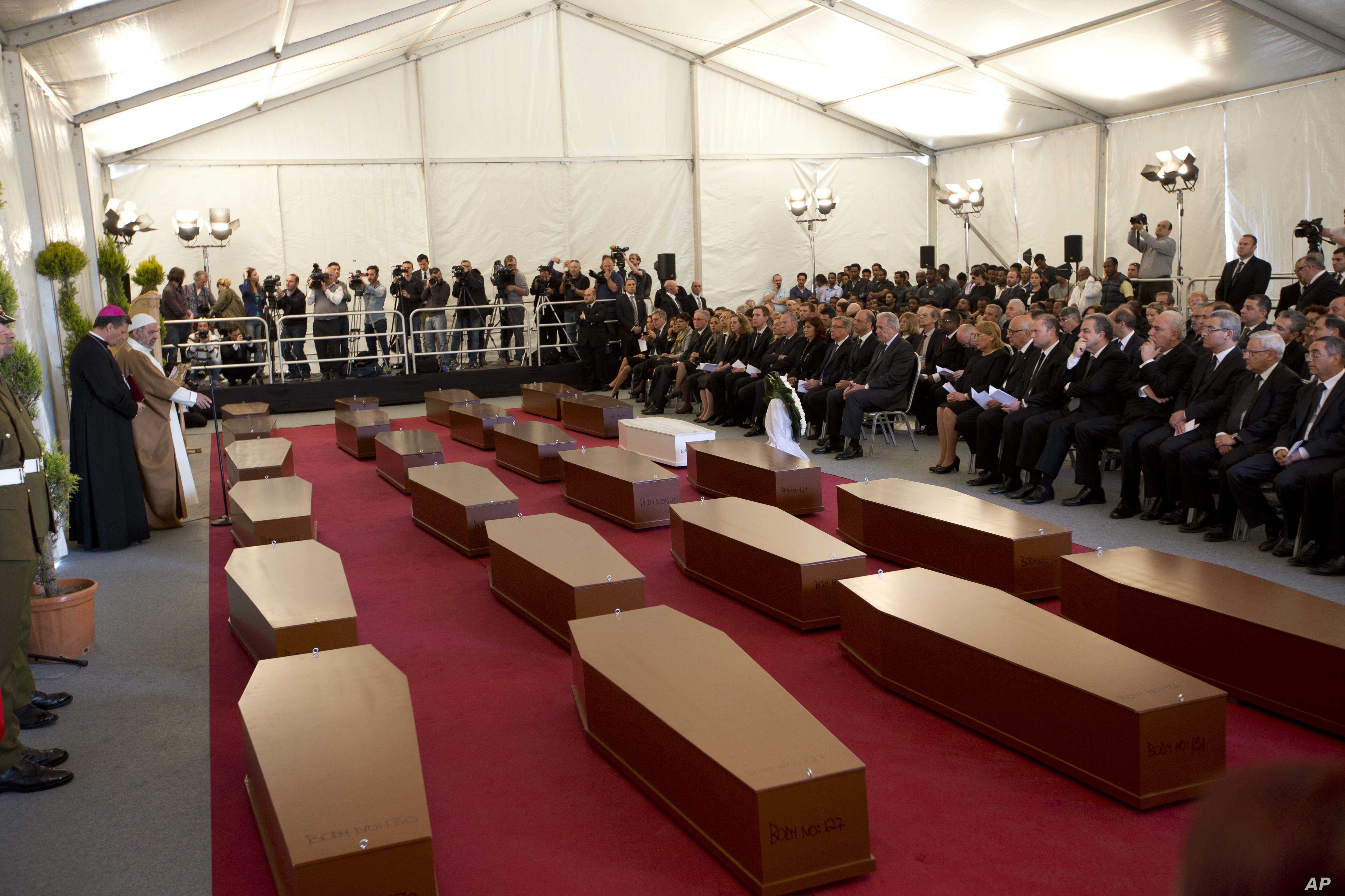 A view of the tent where a funeral service for 24 migrants drowned while trying to reach the Southern coasts of Italy took place, in Msida, in the outskirts of Valletta,  Malta, Thursday, April 23, 2015. The migrants died as a smuggler's boat crammed...