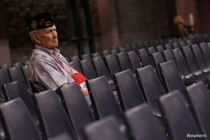 FILE - A veteran watches as U.S. Republican presidential nominee Donald Trump speaks to the Veterans of Foreign Wars conference at a campaign event in Charlotte, North Carolina, July 26, 2016.