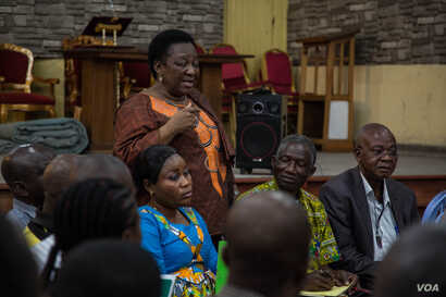 Gertrude Ekombe is very involved in the church's pro-democracy activism. She speaks at a meeting at St. Joseph Catholic Church. (C. Oduah/VOA)