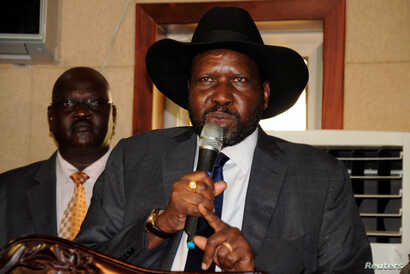 South Sudan's President Salva Kiir addresses delegates during the swearing-in ceremony of First Vice President Taban Deng Gai at the Presidential Palace in Juba, July 26, 2016.