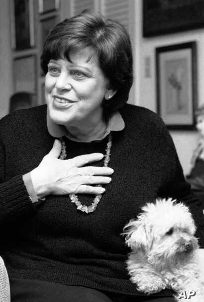 Actress Kaye Ballard gestures during an interview in her New York apartment, Feb. 27, 1984, while her dog, Big Shirley, sits on her lap.