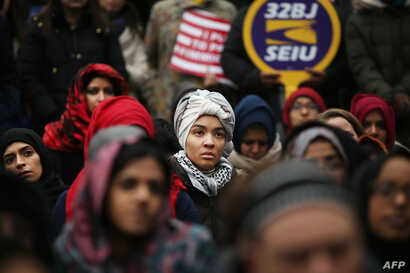 Area Muslims and local immigration activists participate in a prayer and rally against President Donald Trump's immigration policies, Jan. 27, 2017 in New York City.