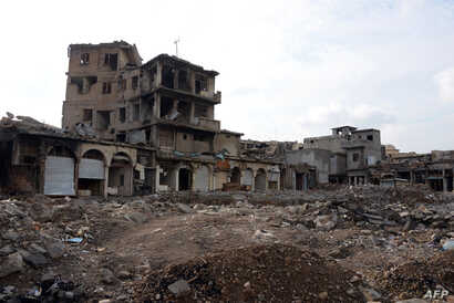 """A picture taken Nov. 7, 2018, shows damaged buildings in Mosul, Iraq. Iraqi forces announced the """"liberation"""" of the country's second city in July 2017, after a bloody nine-month offensive to end the Islamic State group's three-year rule there. Score..."""