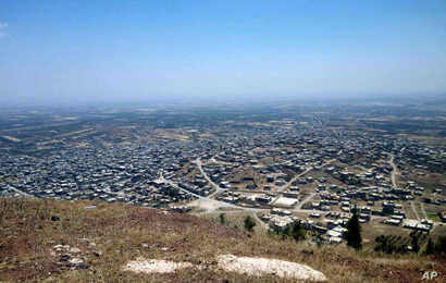 Photo released July 17, 2018 by the Syrian official news agency SANA shows a general view of Tell al-Haara, from the highest hill in the southwestern Daraa province, Syria.